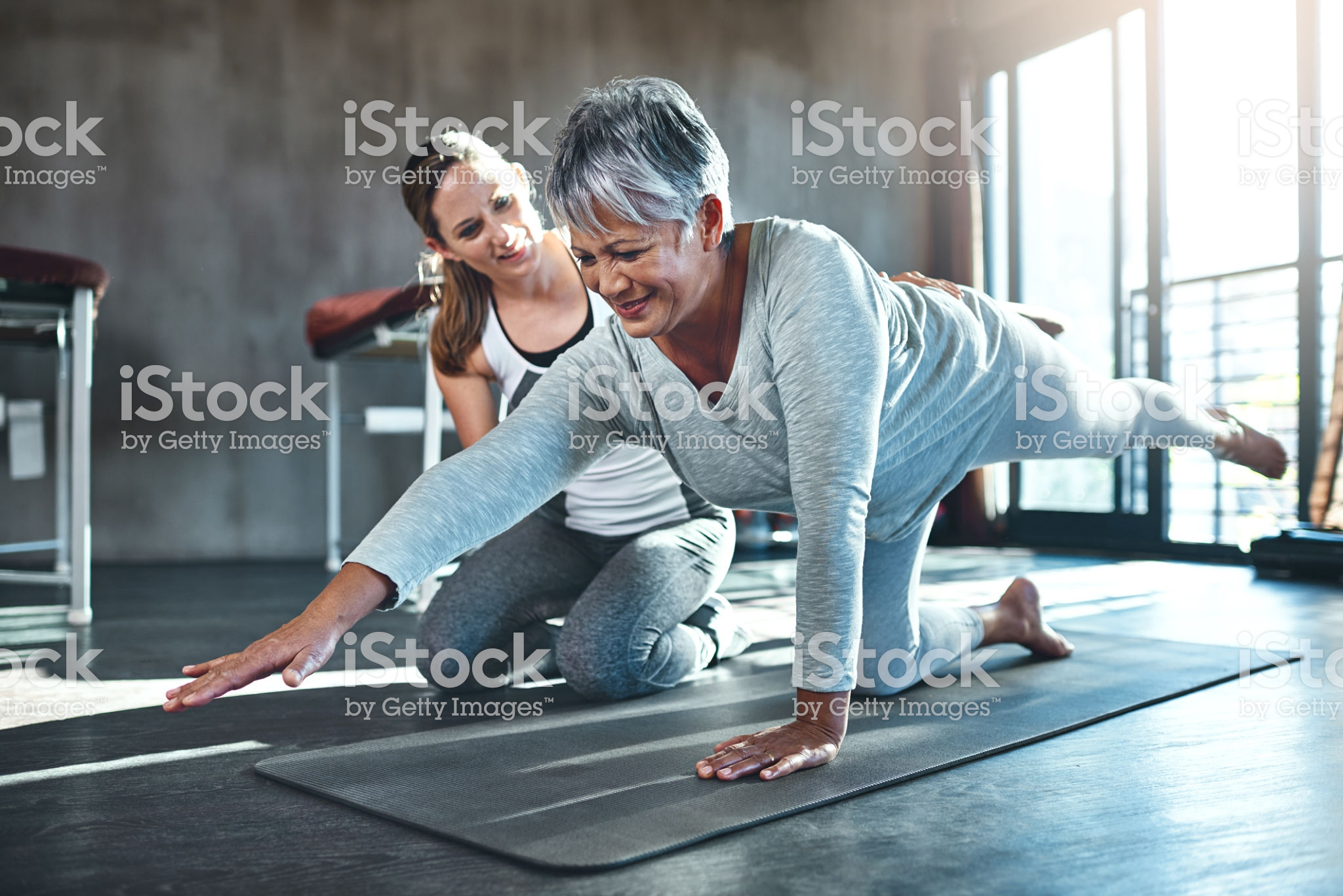Shot of a senior woman working out with her physiotherapist